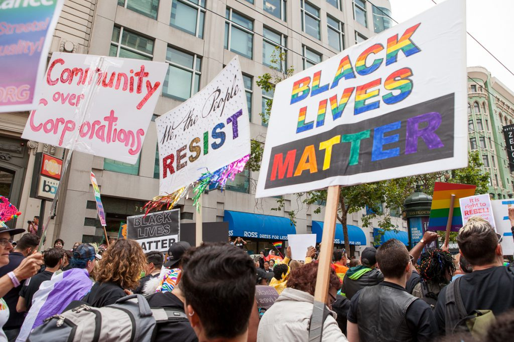 Protest signs at SF Pride